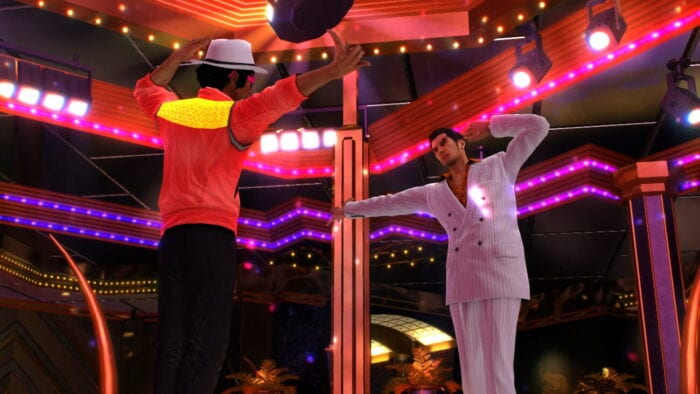 Kiryu poses on the dance floor with Yakuza 0's Michael Jackson knockoff Miracle Johnson