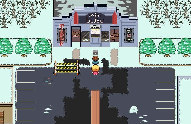 two pixel women stand in front of a shuttered and broken down movie theatre