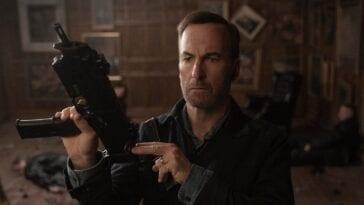 Hutch holding a gun