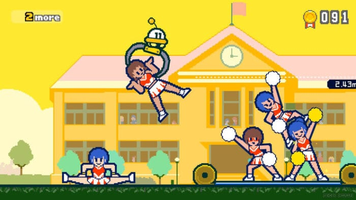 a small UFO lifts a cheerleader with its claws to a tower of other cheerleaders