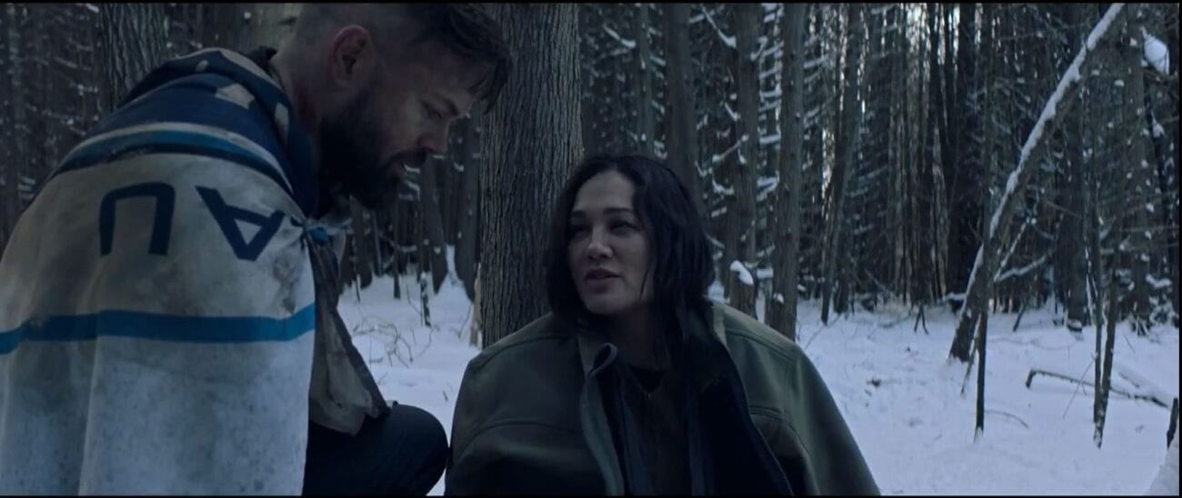 "Amos kneels to the side of Clarissa as she sits in the snowy woods in The Expanse S5E6 ""Tribes"""