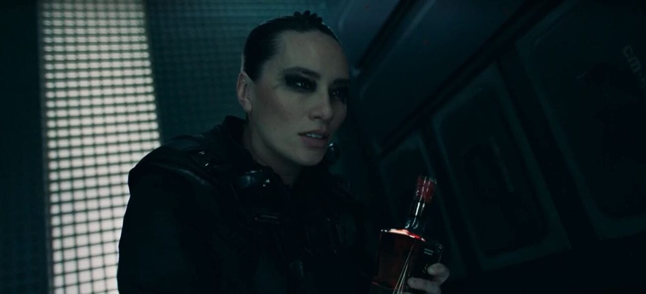 "Drummer in despair as she holds a bottle of liquor in The Expanse S5E8 ""Hard Vacuum"""
