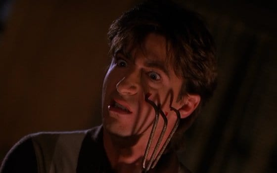 Harold Smith holds a garden fork threateningly to his face