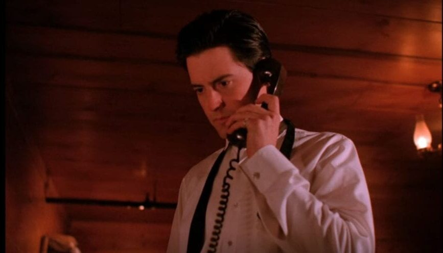 Dale Cooper answers the phone in his room at the Great Northern
