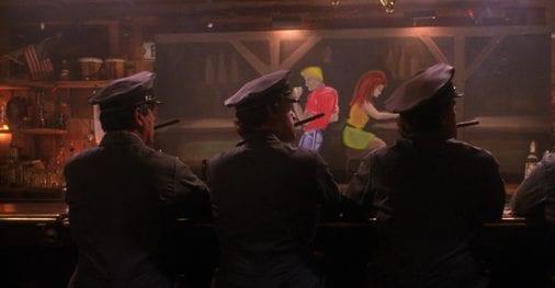 3 men in uniform smoke cigars at the bar at wallies hideout