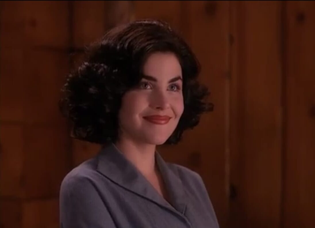 Audrey, dark chin length hair, and blushing smile after being noticed