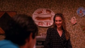 Shelly Johnson serves Bobby Briggs breakfast from the stove.
