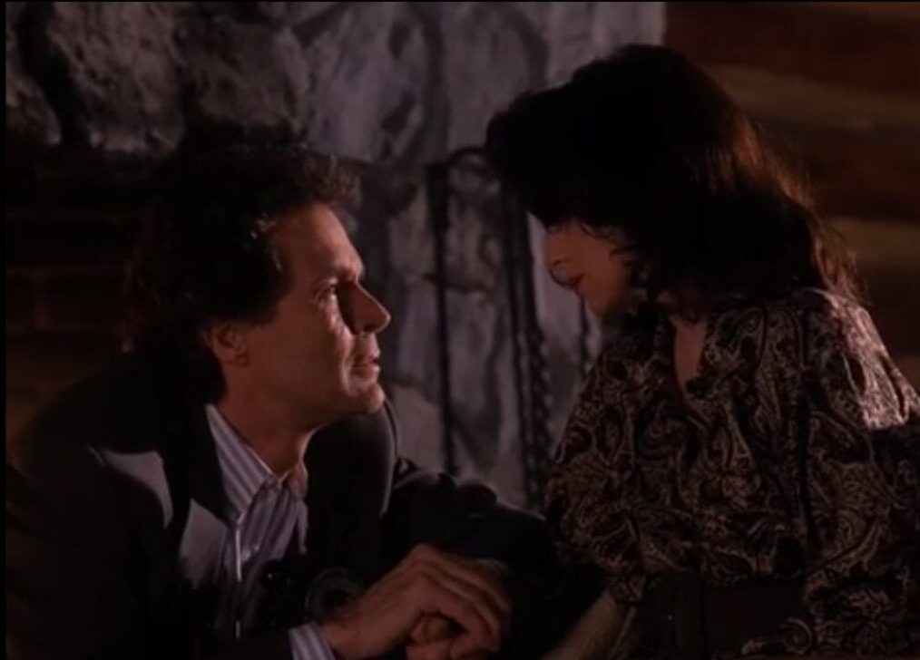 Ben Horne crouches before Eileen, pleading with her.