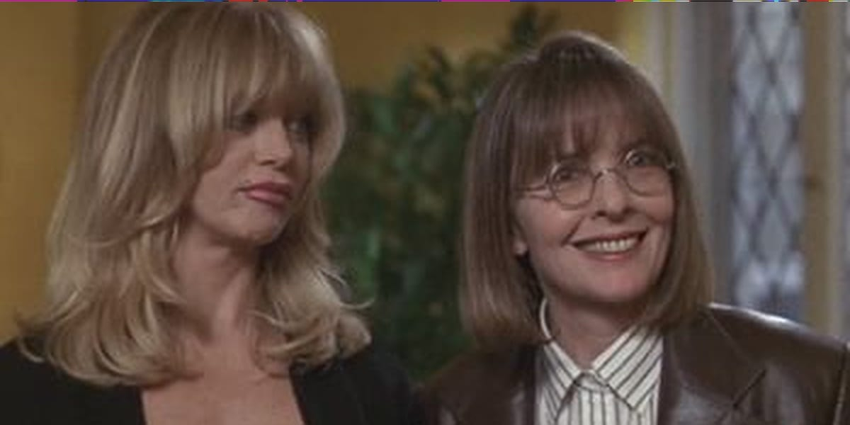 Elise and Annie in The First Wives Club in a dining room