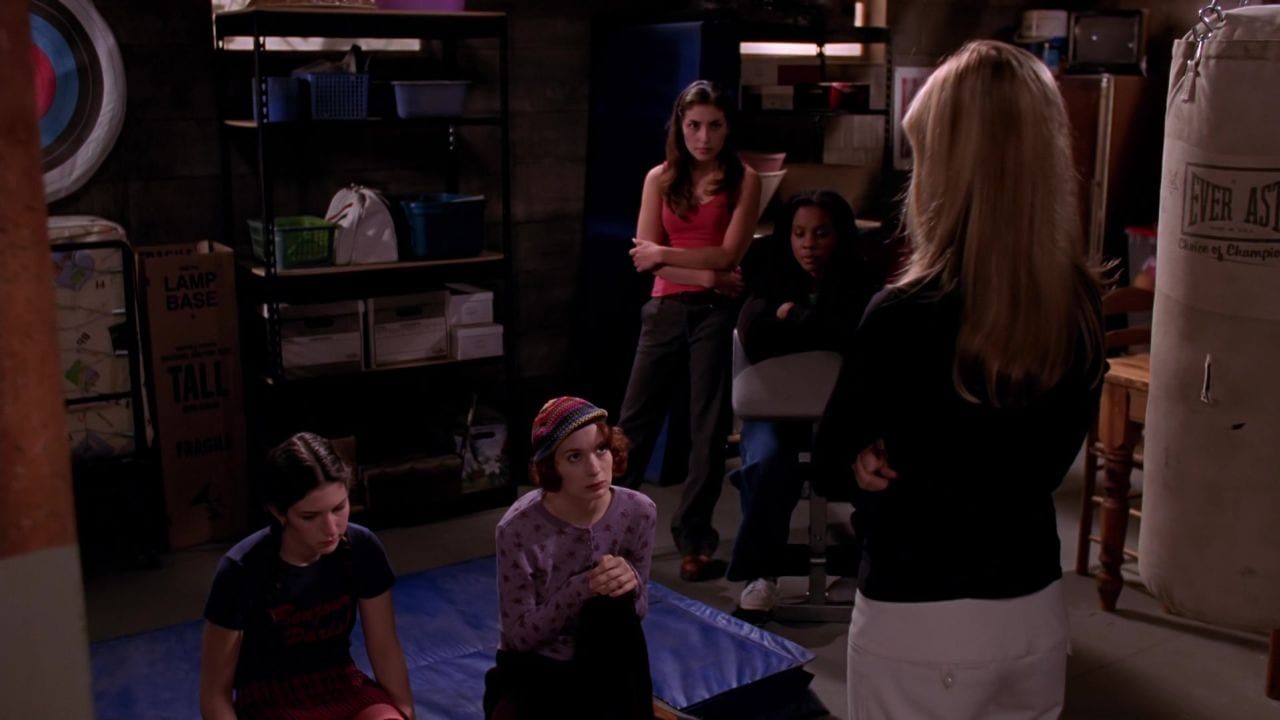 Buffy addresses a group of Potential Slayers.