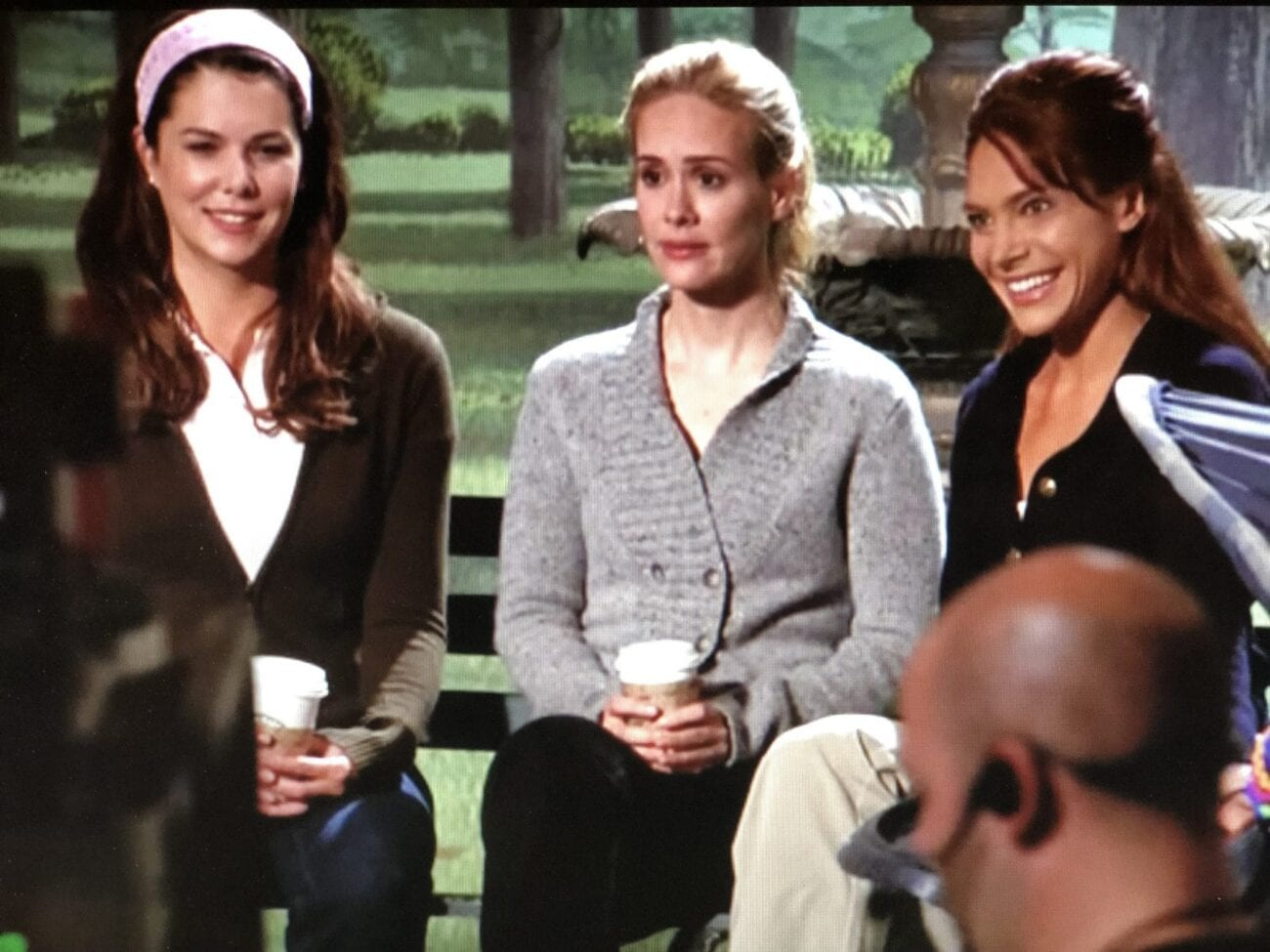Lauren Graham, Harriet, and Jeannie sit on a park bench, during a sketch