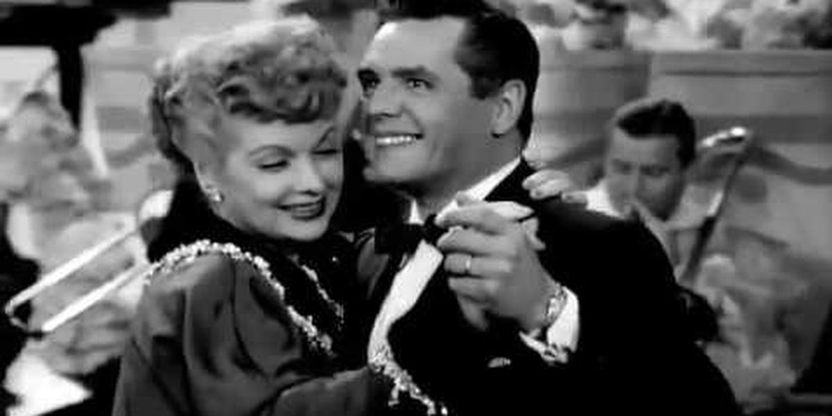 Black and white photo of Ricky and Lucy dancing cheek to cheek in I Love Lucy