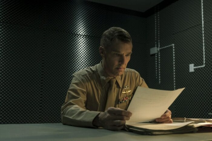 Lt. Col. Couch reads a document at a desk