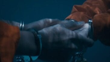 A pair of holding hands, in handcuffs and underwater in The Stand Episode 8