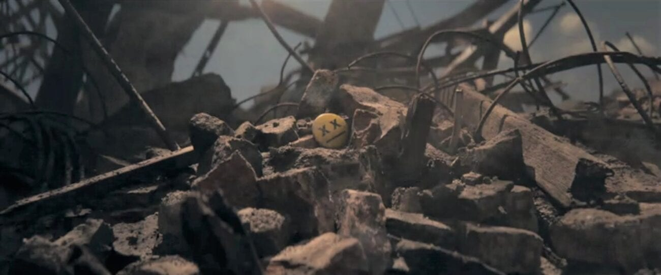 The Stand Episode 9 - Flagg's button, with X's for the eyes, sits on top of a pile of building rubble