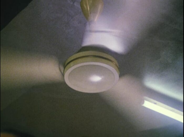 A close-up on a spinning ceiling fan.