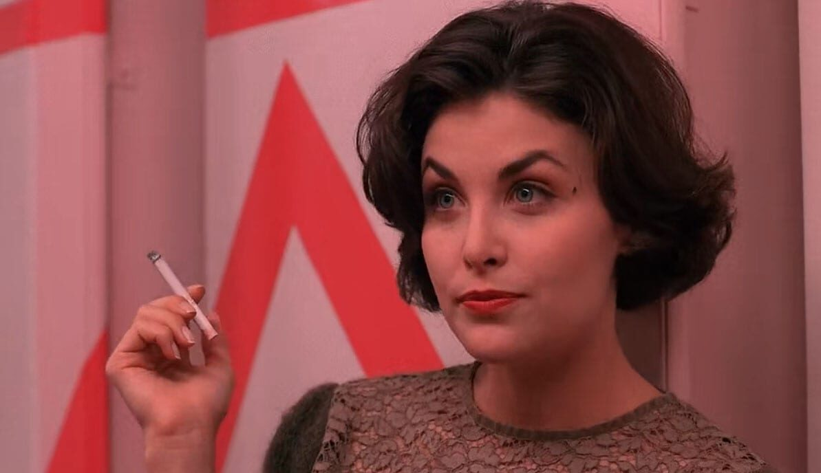 Audrey smokes in twin peaks high school bathroom