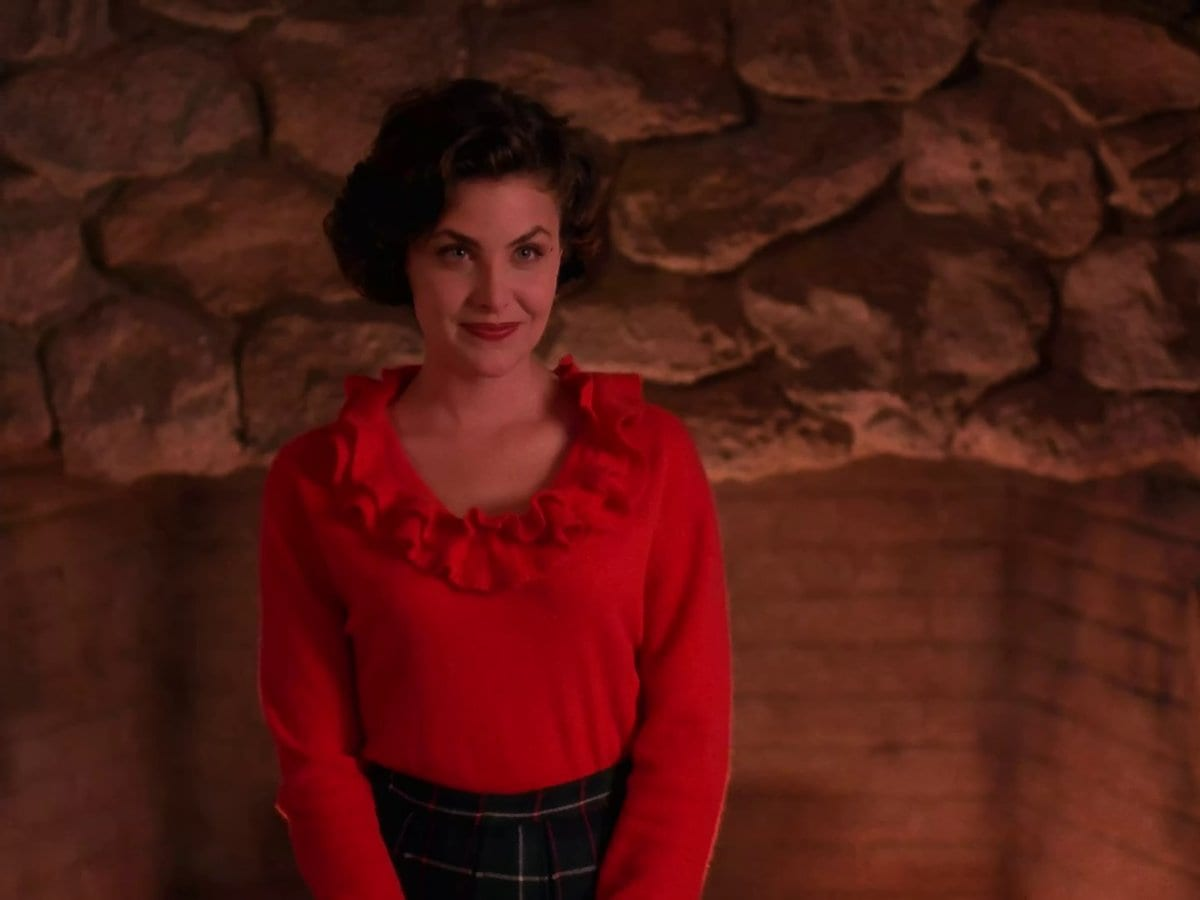 Audrey Horne in red top smiling