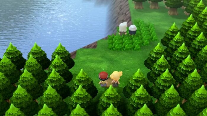 several chibi characters stand among trees looking at a lake