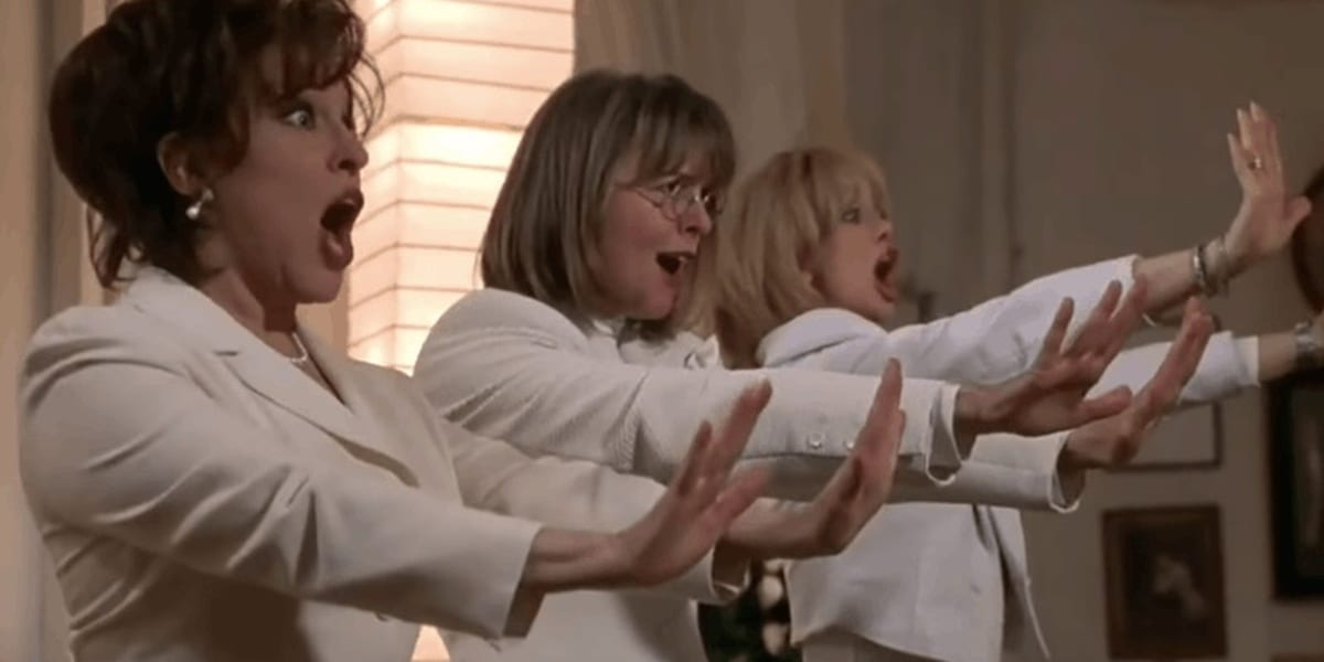 Brenda, Annie and Elise holding out their hands and singing in The First Wives Club