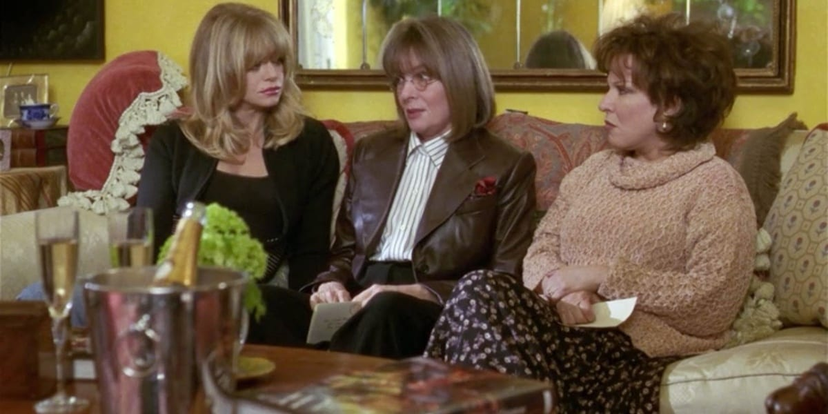 Elise, Annie and Brenda talking and sitting on a couch in The First Wives Club