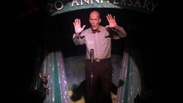 The giant on the miss twin peaks stage waving his arms to warn cooper