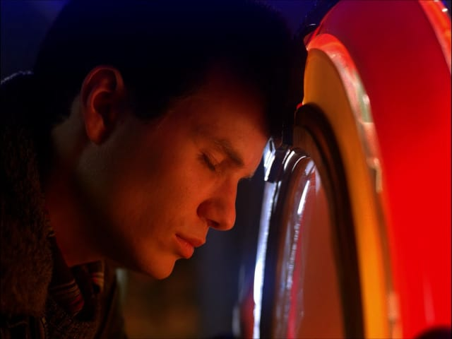 james hurley rests his head on a juke box