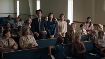 Steven Yeun, Yeri Han, and Yuh-jung Youn stand in a church surrounded by sitting people