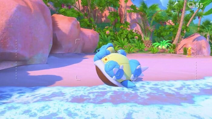 a blastoise sleeps on a beach. a camera lens is aimed at it from a first person perspective