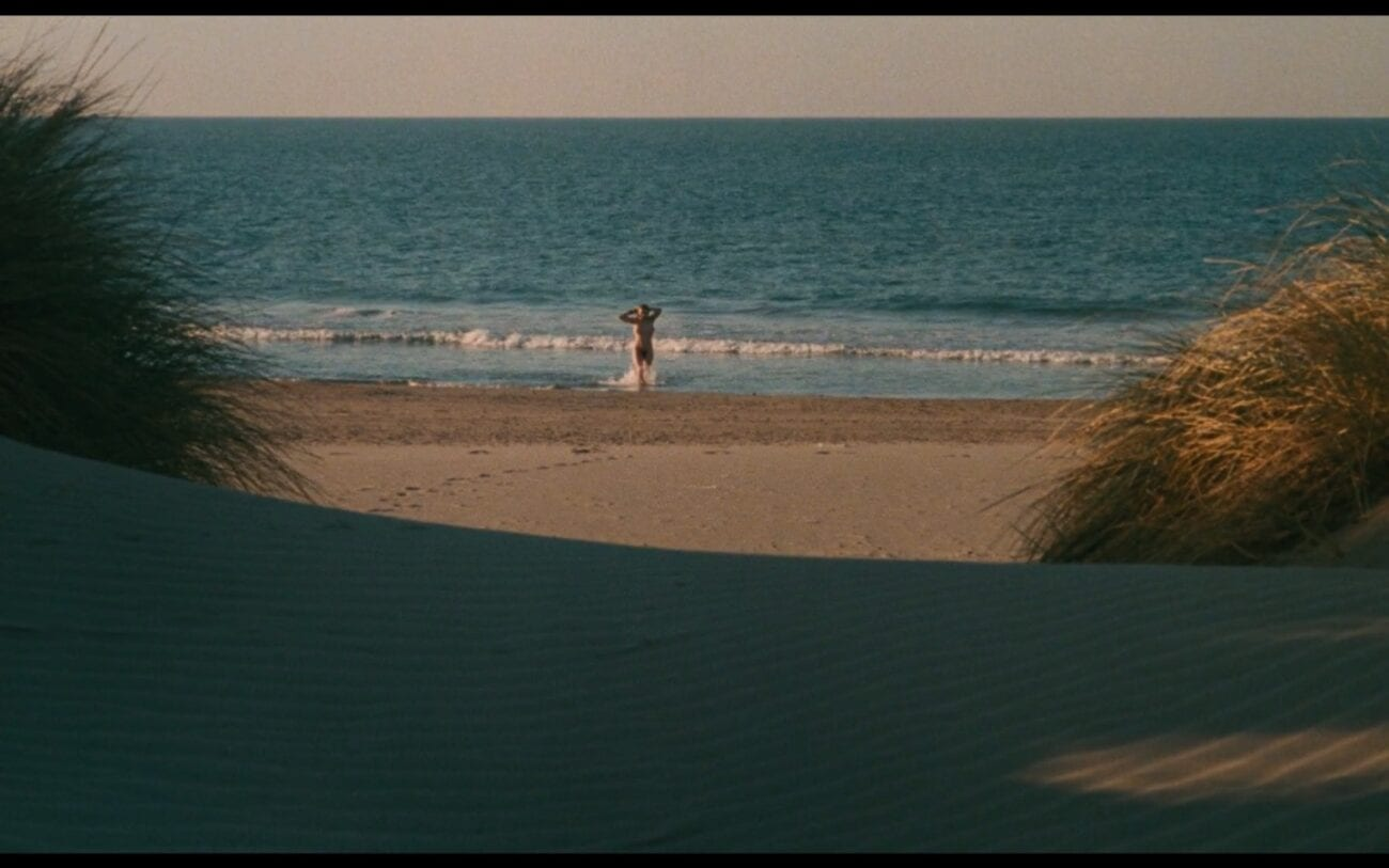 Mona emerging from the sea in the opening shot of Vagabond.