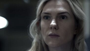 Karen/Emma (Lily Rabe) looks forward into a mirror with different colored eyes in Tell Me Your Secrets S1E1