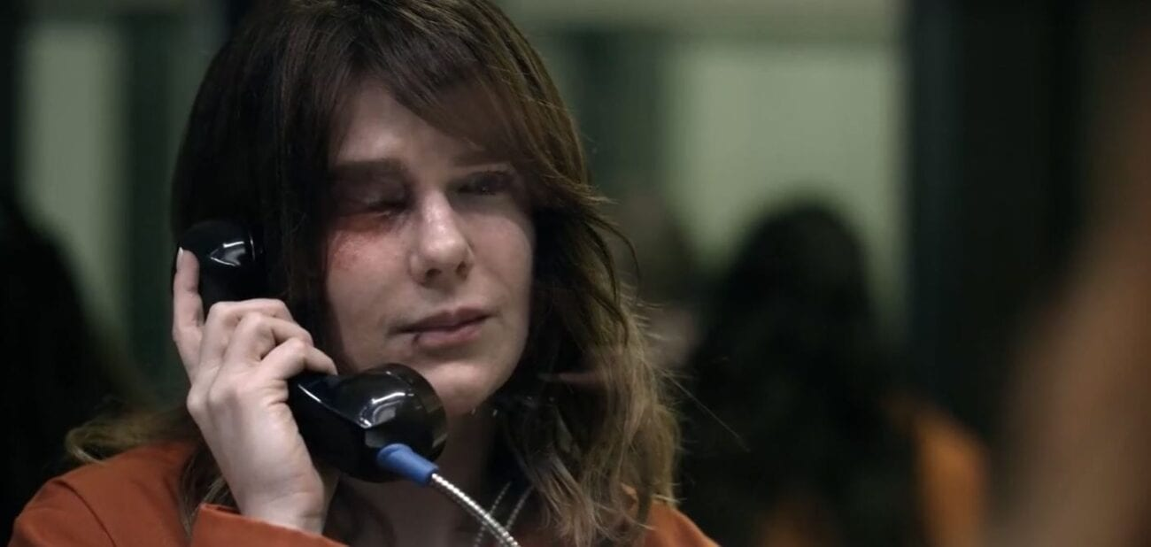 Karen (Lily Rabe) with a battered eye, talking on the phone through prison glass in Tell Me Your Secrets S1E1