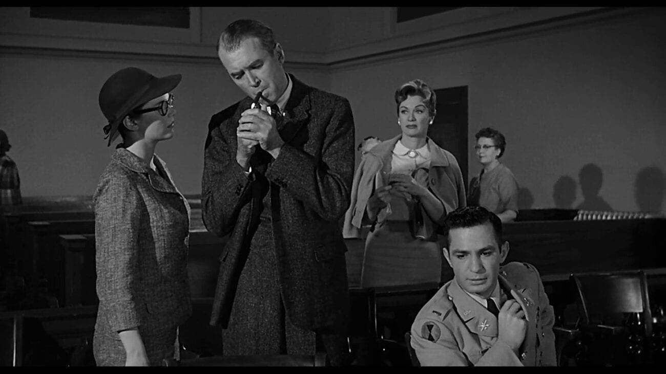 Paul Biegley (James Stewart) lights the cigarette, while Frederick Manion (Ben Gazzara), Laura Manion (Lee Remick) and Maira Rutledge (Eve Arden) stand around looking concerned