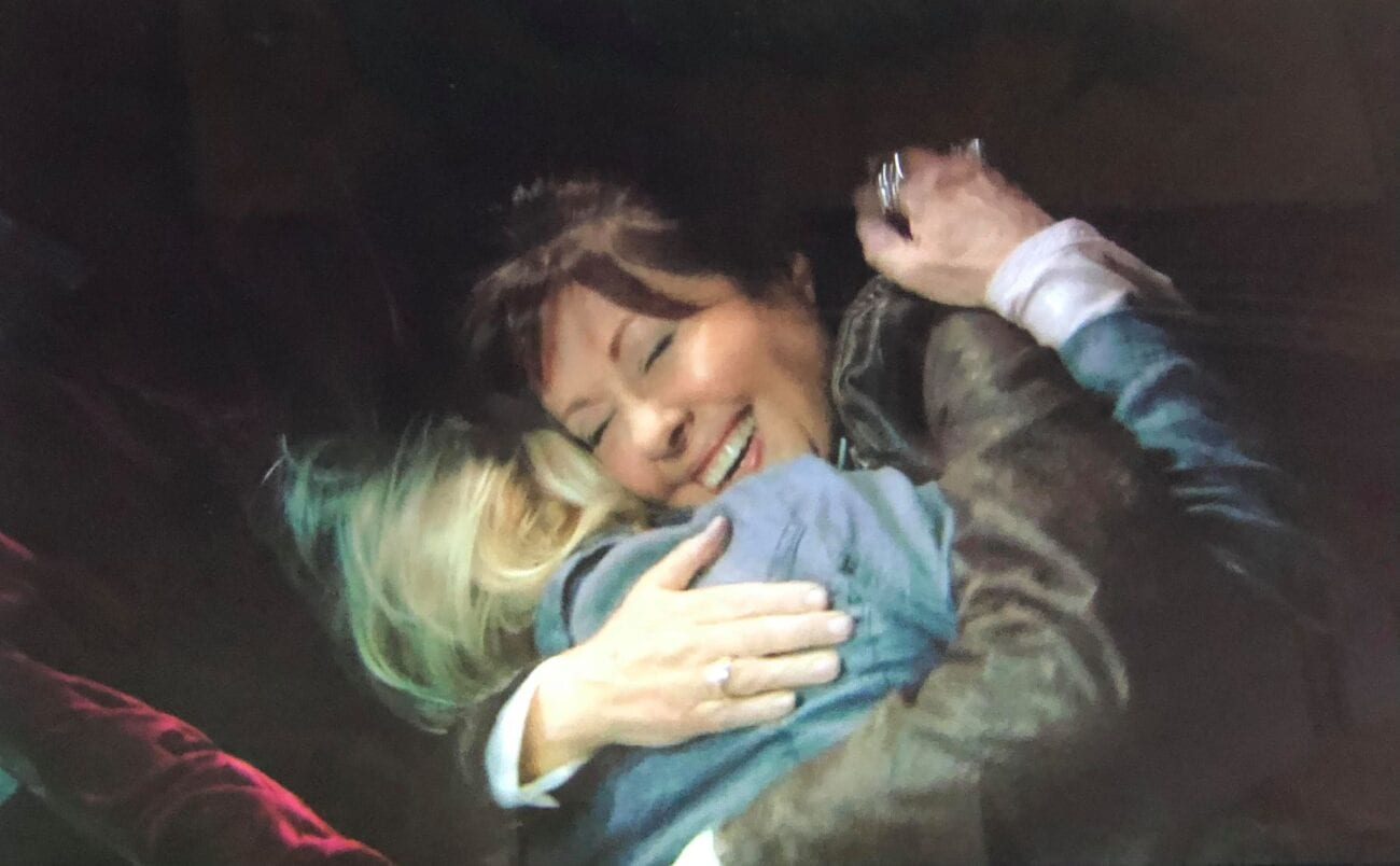 Sarah Jane and Jo happily hugging each other in a big coffin