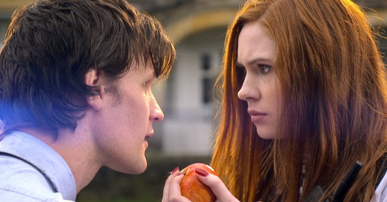 The Doctor (Matt Smith) and Amy (Karen Gillan) look into each other's eyes as she holds an apple