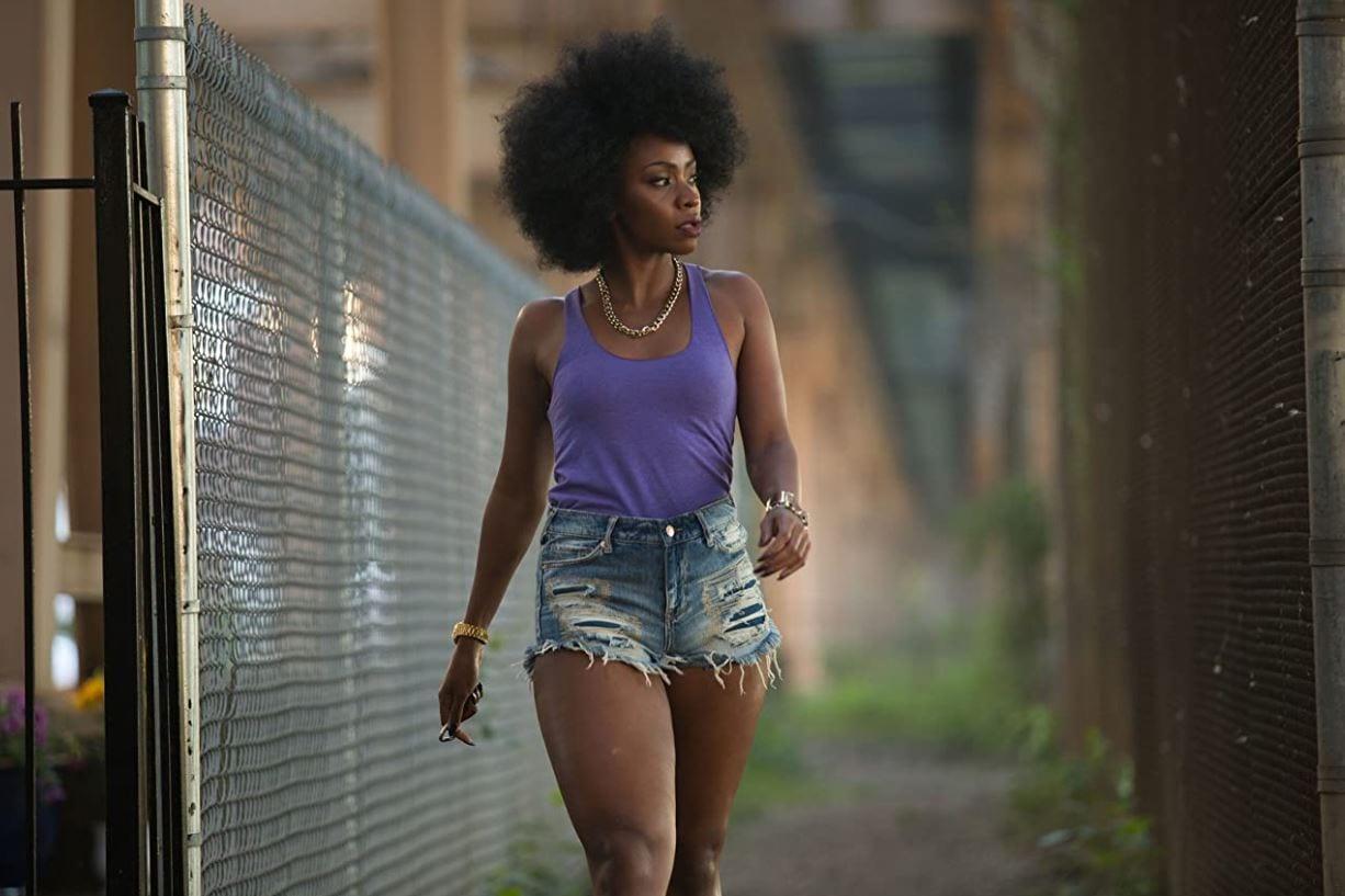 Lysistrata walks down a Chicago sidewalk