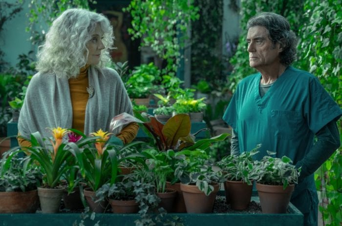 Demeter and Wednesday have a serious conversation in the greenhouse of the home