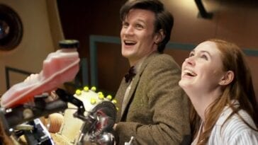 The Doctor (Matt Smith) and Amy Pond (Karen Gillan) in the TARDIS interior at the console looking toward the ceiling