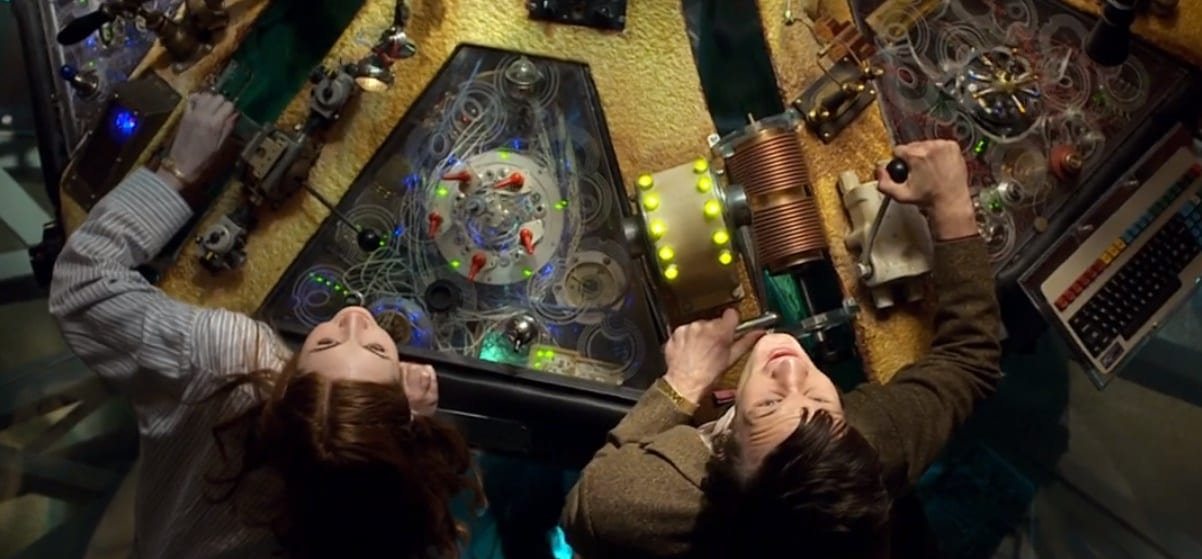 The Doctor (Matt Smith) and Amy Pond (Karen Gillan) at the TARDIS console shot from overhead