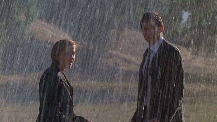 Mulder and Scully soaked in the rain...