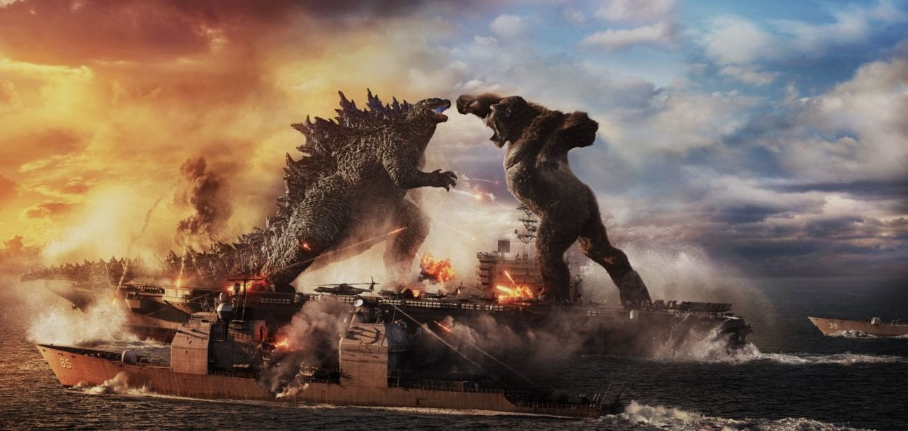 Kong swings a punch towards Godzilla while the two stand on an aircraft carrier.