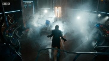 A silhouette of the newly regenerated Thirteenth Doctor in the TARDIS, lights glaring