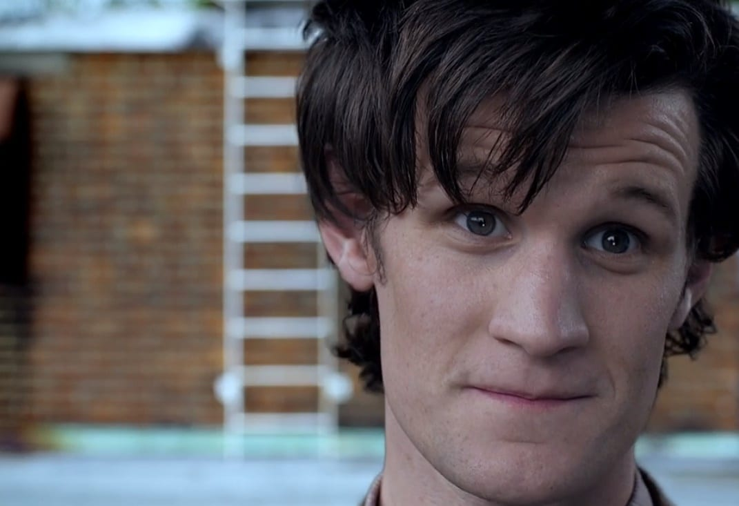 A close up of the Doctor's (Matt Smith's) face with a ladder and brick wall in the background