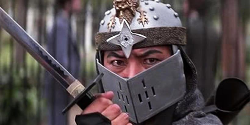 Akira Saito wearing a metal mask and holding a sword in Pray for Death