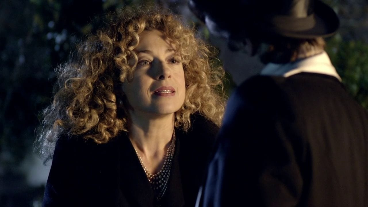 """River Song (Alex Kingston) whispers to the Eleventh Doctor (Matt Smith) in the """"Doctor Who"""" episode """"The Big Bang"""""""