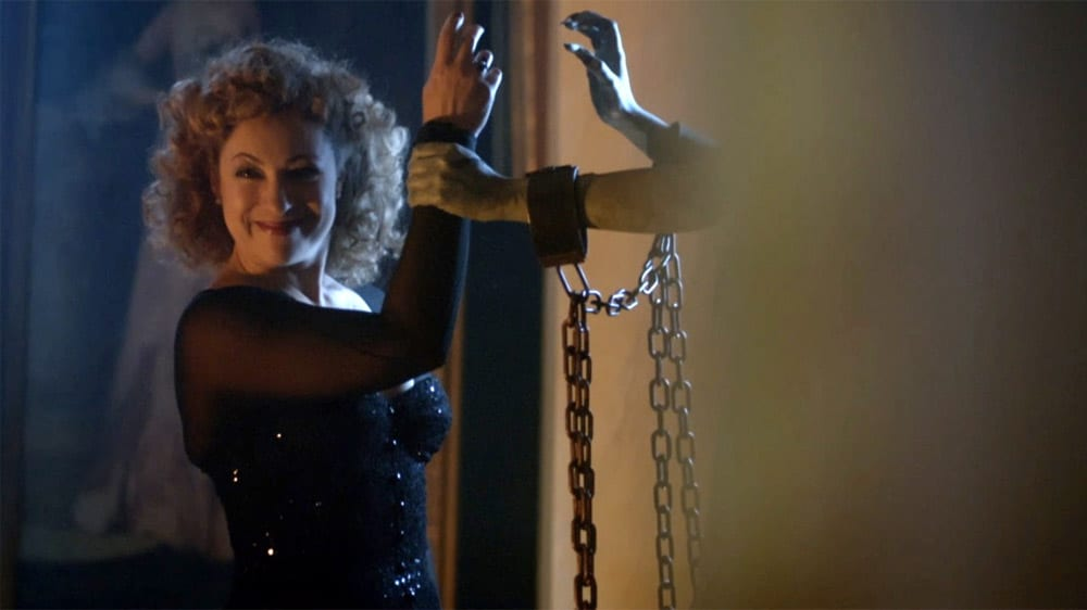 """River Song (Alex Kingston) smiles while being held captive by a Weeping Angel in the """"Doctor Who"""" episode """"The Angels Take Manhattan"""""""