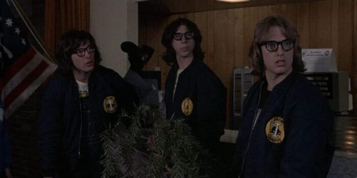The Hanson brothers gaze across a motel lobby.