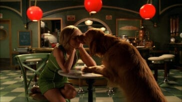 Olive (Kristen Chenoweth) gets doggy kissed.