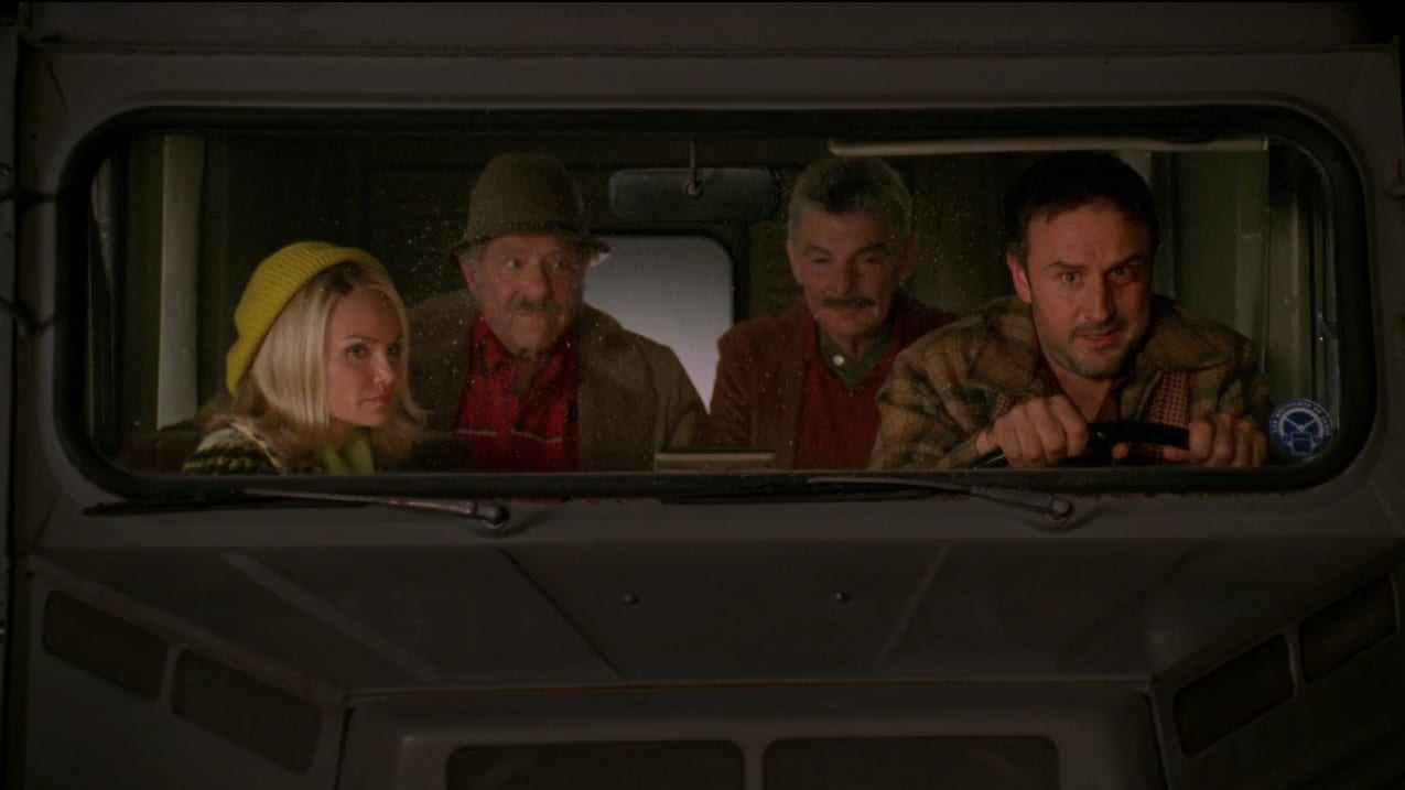 Olive (Kristen Chenoweth) is in a car with Jerry and Buster with Randy (David Arquette) driving.