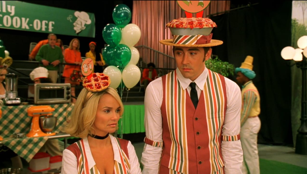 Olive (Kristen Chenoweth) talks with Ned (Lee Pace) while in pie uniforms.